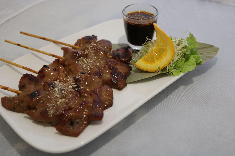 Moo ping (4 skewers)