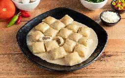Gnocchi Truffle & Ricotta Filling in Porcini Mushroom sauce